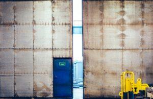 Factory, warehouse grunge industrial gate open